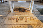 Below the altar is the 5th century mosaic of 2 fishes flanking a basket containing 5 loaves of bread and also the block of limestone on which the miraculous meal was laid.